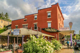23)   Thomas, West Virginia       About: While many venture to better-known Berkeley Springs in West Virginia, there's a good reason this old coal mining town is on the rise. Rally the crew for a self-guided walking tour of its historic homes (Thomas has more than 50 homes and sites on the National Historic Register) before winding down at  The Purple Fiddle , a live music venue with homemade ice cream that you won't want to miss. Outdoor junkies should spend some time getting lost in  Blackwater Falls State Park , though just about anyone can benefit from its breathtaking views and fresh country air. Be sure to check yourselves into the funkily furnished  Cooper House Bed & Cocktai l for a mountain town vacation you and your girls will be reminiscing over for years to come.    More Info:   gotowv.com