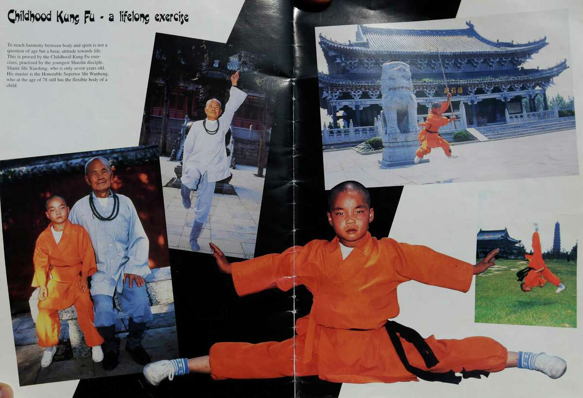 A promotional catalog for the 1996 tour of Shaolin kung fu features a page dedicated to Feng, then six, and his master, then 78.