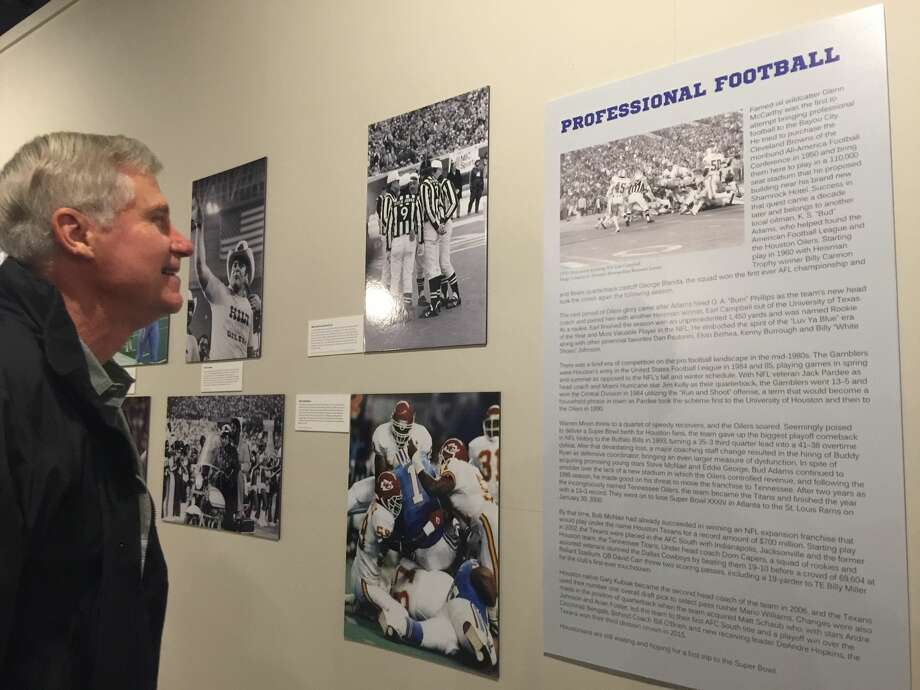 "Michael Farr checks out ""Bayou City Blitz: The History of Houston Football"" exhibit at the Heritage Society at Sam Houston Park. Photo: J.R. Gonzales"