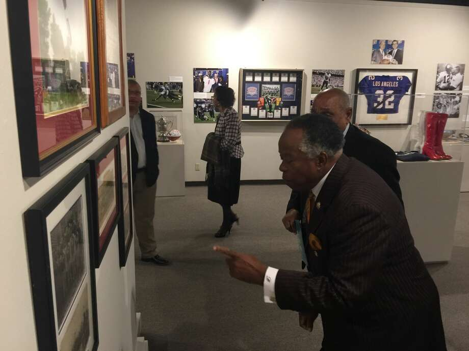 Pastor Donald Dickson looks over some photos from the Turkey Day Classic between Yates and Wheatley at the Heritage Society. Photo: J.R. Gonzales