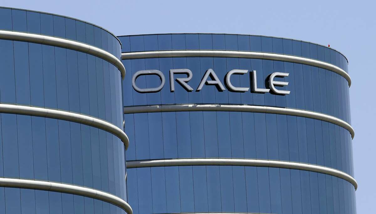 FILE - This June 18, 2012, file photo shows Oracle headquarters in Redwood City, Calif. The Labor Department is suing Oracle, claiming that the technology giant pays white male workers more than their non-white and female counterparts with the same job titles. In a statement issued Wednesday, Jan. 18, 2017, Oracle called the lawsuit