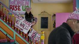 Brienne Kordis, of Washington DC hangs protest banners to dry at the Code Pink House in Washington D.C. office on Wednesday January 18, 2017.