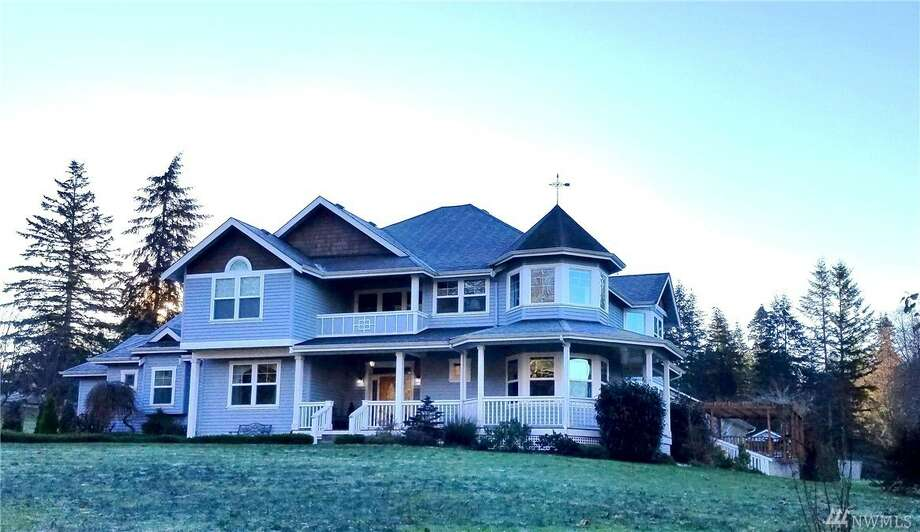 This home at 8928 201st St. N.W. in Stanwood is listed for $789,000.The four bedroom, 4½ bathroom home was custom built in 2005. It spans more than 5,000 square feet, and features water views from nearly every room.The home includes beautiful details, such as a hand-carved staircase, a crystal chandelier that can be lowered electronically and an expansive kitchen that can accommodate multiple chefs.Outside, there is a five-car garage and an additional 1,200-square-foot two-room office or studio.You can see the full listing here. Photo: Photos By Wicked Photography, Listing Courtesy Eva Bryce, CENTURY 21 North Homes Realty