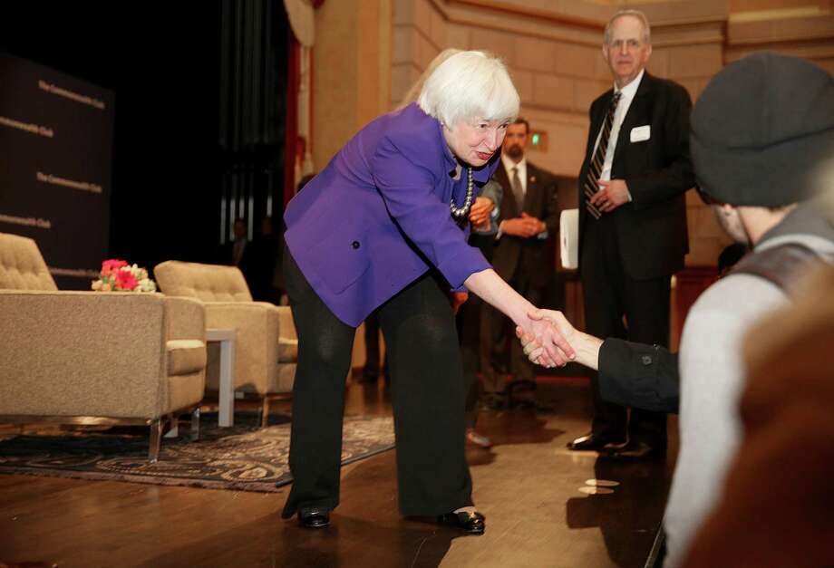 Federal Reserve Chair Janet Yellen greets some students at the Commonwealth Club after speaking Wednesday in San Francisco. Yellen says she expects the Fed to raise its benchmark interest rate several times a year through 2019, but she can't say when the next interest rate will occur or how high rates will rise. Photo: Liz Hafalia /San Francisco Chronicle / online_yes