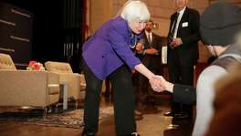 Federal Reserve Chair Janet Yellen greets some students at the Commonwealth Club after speaking Wednesday in San Francisco. Yellen says she expects the Fed to raise its benchmark interest rate several times a year through 2019, but she can't say when the next interest rate will occur or how high rates will rise.