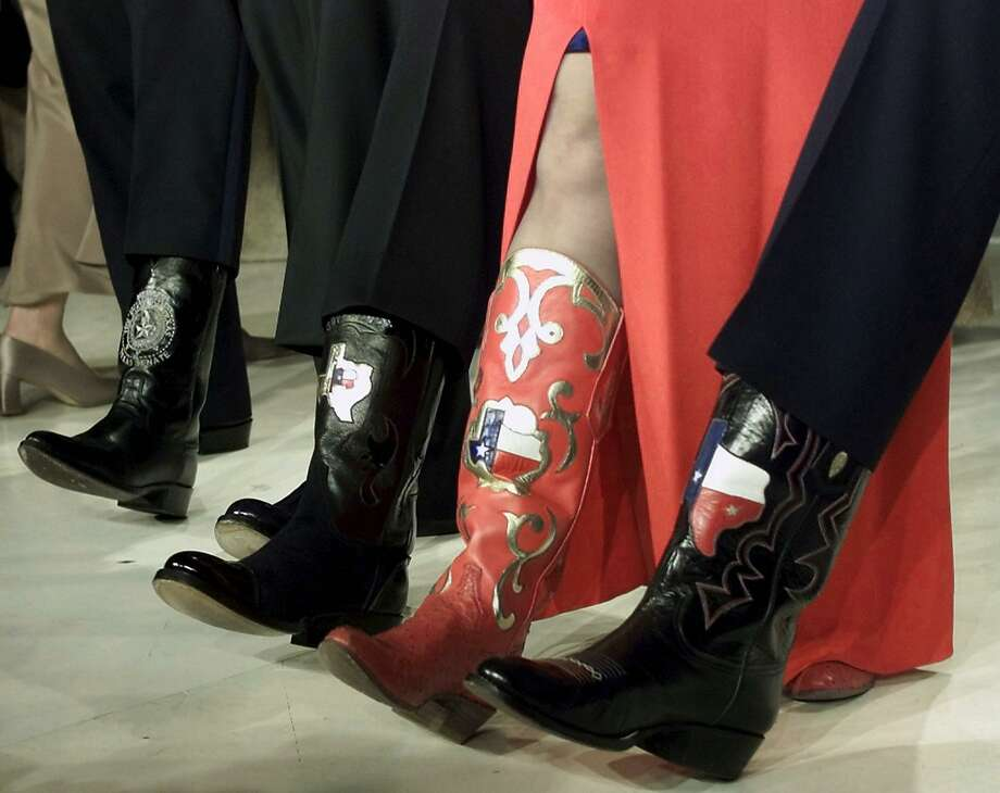 WASHINGTON, :  A lineup of Texas boots belonging to (L-R) US President-elect George W. Bush, Rick Perry, Governor of Texas; Senator Kay Bailey Hutchinson and Senator Phil Graham both of Texas on stage at the Texas State Black Tie and Boots Ball at the Marriott Wardman Park 19 January, 2001, in Washington, DC.   AFP PHOTO / TIM SLOAN (Photo credit should read TIM SLOAN/AFP/Getty Images) Photo: TIM SLOAN/AFP/Getty Images