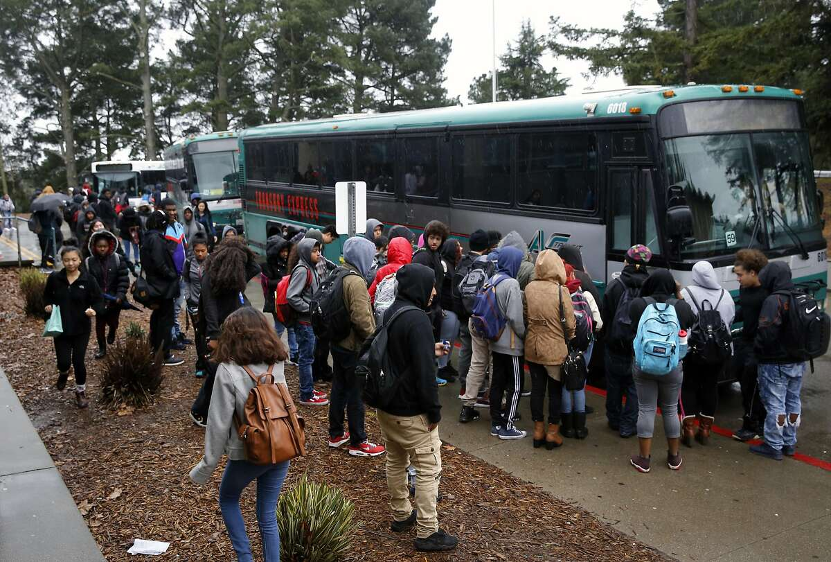 Skyline high school students board A/C Transit buses after their school day in Oakland, Ca., on Wednesday Jan. 18, 2017.