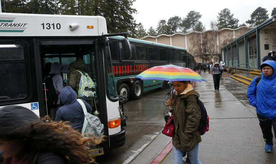 Skyline High School students board AC Transit buses to head home after school lets out Wednesday. Photo: Michael Macor, The Chronicle