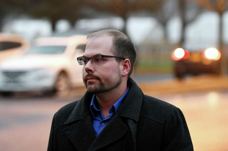Brian Tromans, 33, of Melrose, the motorist allegedly behind the hit-and-run that killed New York National Guard master sergeant Rudolph E. Seabron in Latham on Jan. 8, walks to  Colonie police headquarters where he turned himself in on Wednesday evening, Jan. 18, 2017, in Colonie, N.Y. (Will Waldron/Times Union) Photo: Will Waldron / 20039481A