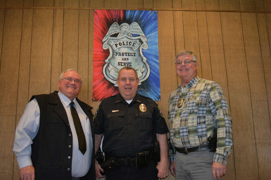 Police Capt. Dennis Harkins (left) and Sgt. Stan Branam (right) pose with Plainview Police Chief Ken Coughlin in the lobby of the Police Records Department on Wednesday. Harkins and Branam will be honored at a joint retirement reception 3:30-5:30 p.m. Thursday, Jan. 19, inside Council Chambers at Plainview City Hall, 901 Broadway. The public is invited, particularly at 4 p.m. for special presentations. The two are retiring with a combined 69 1/2 years of service as certified officers with the Plainview Police Department.