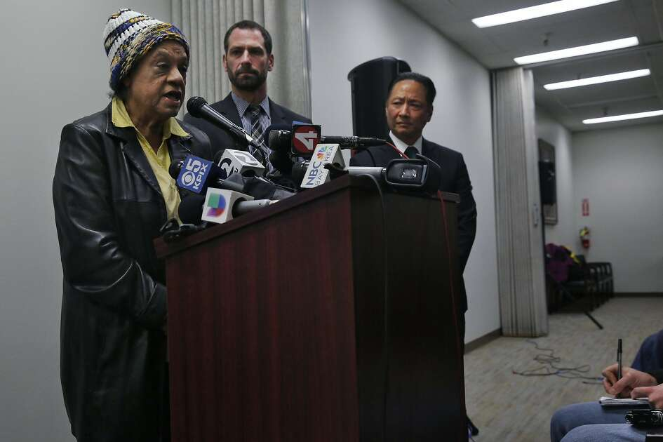 Cleo Moore, the mother of Sean Moore, who was shot by police officers addresses the media as Deputy Public Defender Brian Pearlman, center, and San Francisco Public Defender Jeff Adachi stand by her side during a press conference wherein body camera footage of an officer involved shooting was released at the San Francisco Public Defender's office Jan. 18, 2017 in San Francisco, Calif. The non-fatal shooting, which occurred in Ocean View earlier this month, involved a mentally-ill man who was shot by a police officer who, along with his partner who was also on scene, offered statements that conflict with the body camera footage.