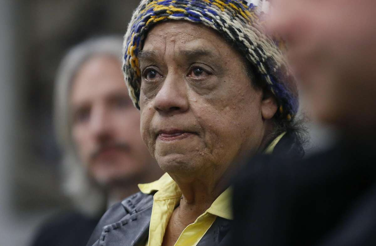 Cleo Moore, the mother of Sean Moore, who was shot by police officers watches as San Francisco Public Defender Jeff Adachi plays the body camera footage of the officer shooting her son at a press conference where the footage was released at the San Francisco Public Defender's office Jan. 18, 2017 in San Francisco, Calif. The non-fatal shooting, which occurred in Ocean View earlier this month, involved a mentally-ill man who was shot by a police officer who, along with his partner who was also on scene, offered statements that conflict with the body camera footage.