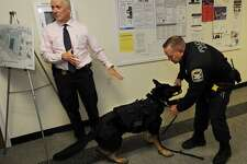 Ansonia Police Chief Kevin Hale, left, and K9 Officer Paul Smith show off the new bulletproof vest donated for police dog Kane by Ansonia resident David Shepherd at the Ansonia Police Department on Monday.