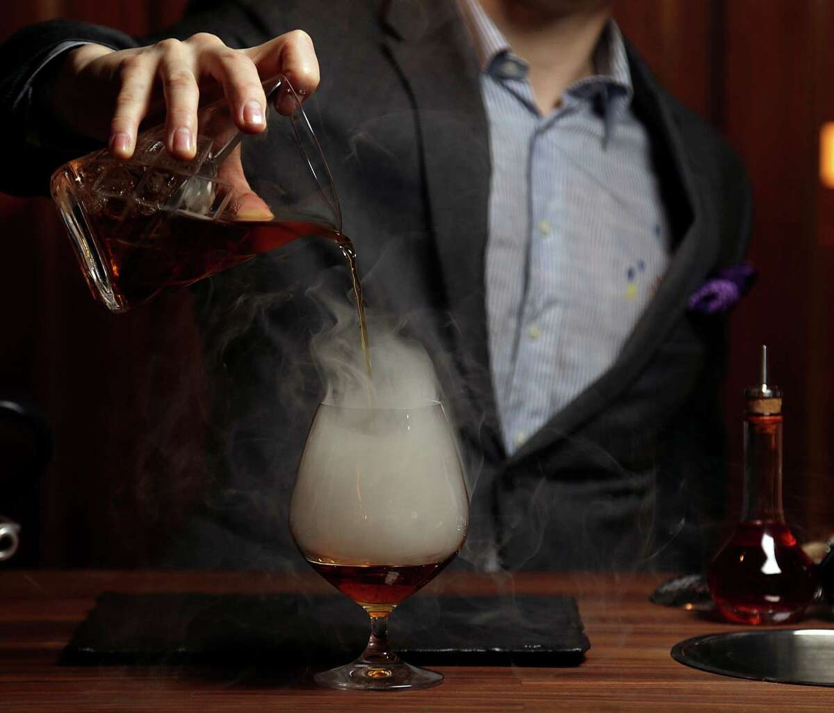 The Huntsman cocktail (scotch, Punt e Mes, apricot, and tea smoke at Bayou & Bottle in the Four Seasons Hotel Houston opening Jan. 21.