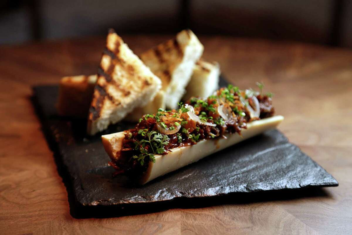 Bone marrow and oxtail with brioche toast and stone fruit mostarda at Bayou & Bottle in the Four Seasons Hotel Houston opening Jan. 21.