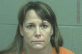 Christy Glynn White, 44,  was arrested Tuesday after she allegedly used a handgun in the commission of an assault, according to court documents.