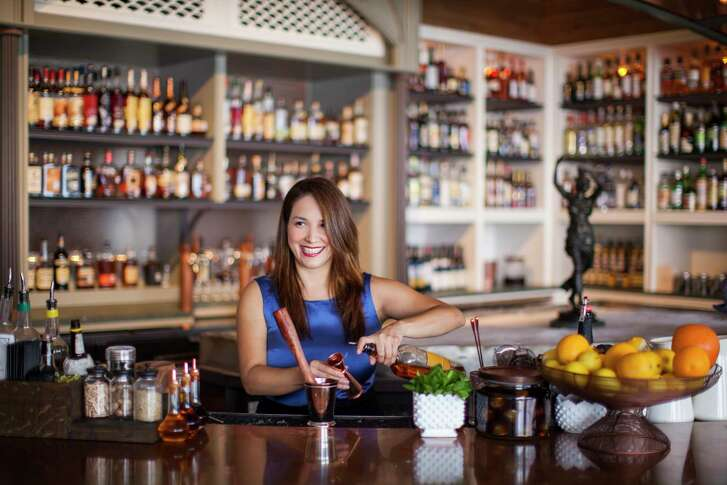 Julep owner Alba Huerta making a cocktail at her bar on Washington.