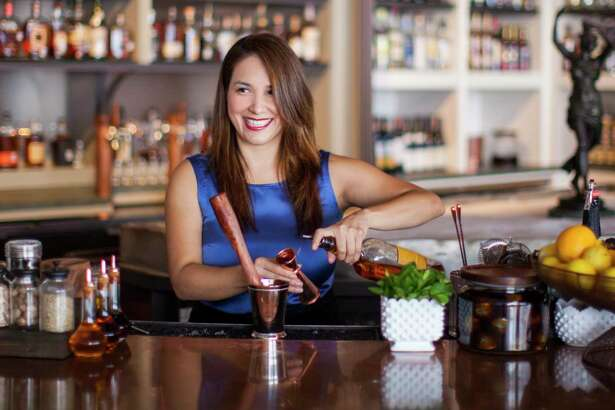 Julep owner Alba Huerta making a cocktail at her bar on Washington.