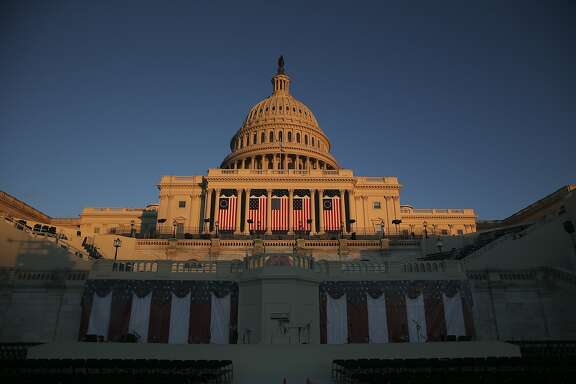 The U.S. Capitol building stands in Washington, D.C., U.S., on Wednesday, Jan. 18, 2017. Wall Street's expectations that Donald Trump will quickly free banks from the grip of aggressive regulators could encounter a problem: Some of Barack Obama's top appointees aren't planning to leave anytime soon. Photographer: Daniel Acker/Bloomberg