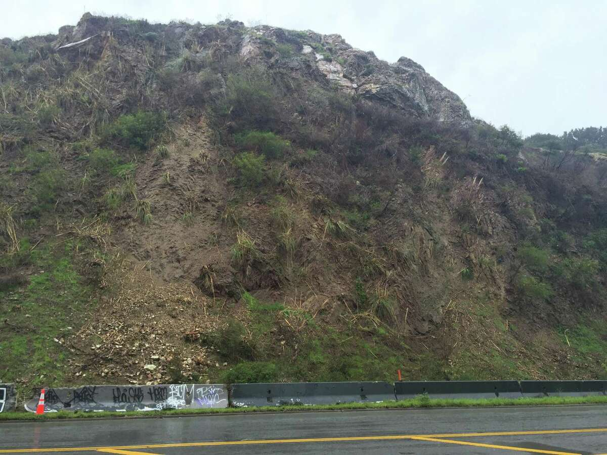 San Francisco public works crews shut down O'Shaughnessy Boulevard, between Malta Drive and Del Vale Avenue, Wednesday to stabilize this cliff that has been eroding in recent rain storm.