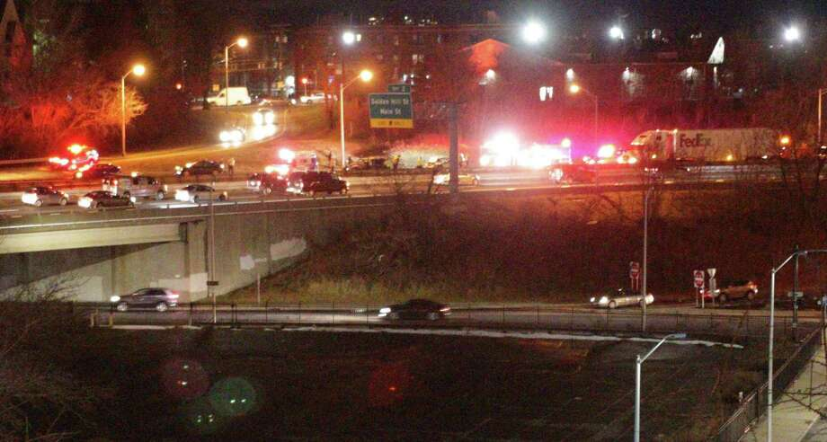First responders work at an accident involving multiple vehicles on Route 8, Bridgeport, CT, Jan. 18, 2017 Photo: Hearst Connecticut Media / Connecticut Post