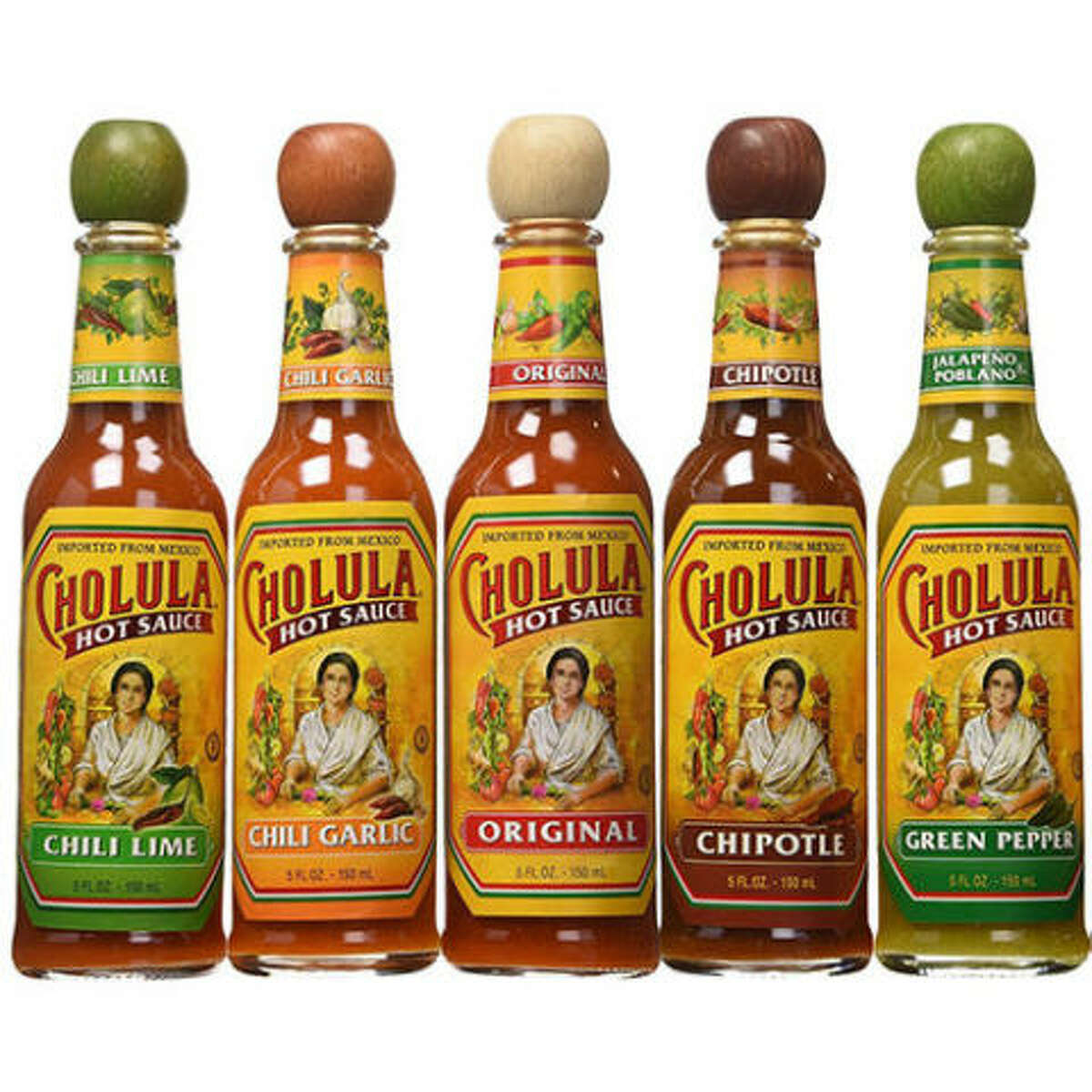 1. Cholula We're putting Cholula at the top of our list because of its versatility. You can put Cholula on snacks, your eggs in the morning, your lunch tacos o tu sopita de la cena. It's not too runny and it's got a bold, addictive flavor every Mexican household appreciates. We personally prefer the chili lime green cap over traditional, but you know we've got both of them stocked in our kitchen.