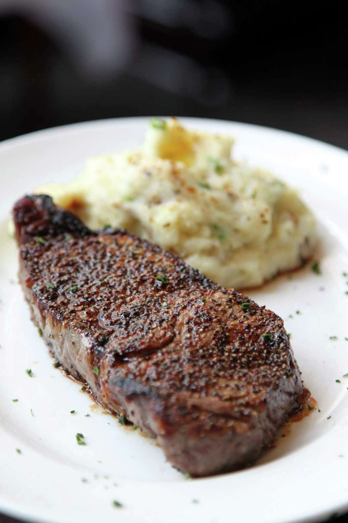 USDA Prime New York Strip and Chateau Potatoes is one of three dishes served at Del Frisco's during Houston's Restaurant Week on Saturday, July 27, 2013, in Houston. ( Mayra Beltran / Houston Chronicle )