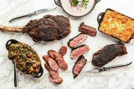 One Fifth Steak might feature menu items such as,clockwise from top: Jimmy Red Corn porridge, Grit Spoonbread, Cast Iron-Seared New York Strip, Sliced Cast Iron Ribeye, Bacon Sausage, Bacon Sausage Creamed Collard Greens and Bone-In Ribeye.