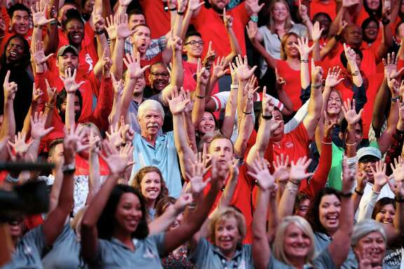 The Houston Super Bowl LI Host Committee superstar volunteers hold their hands up -- five and one -- during the orientation at the Toyota Center.