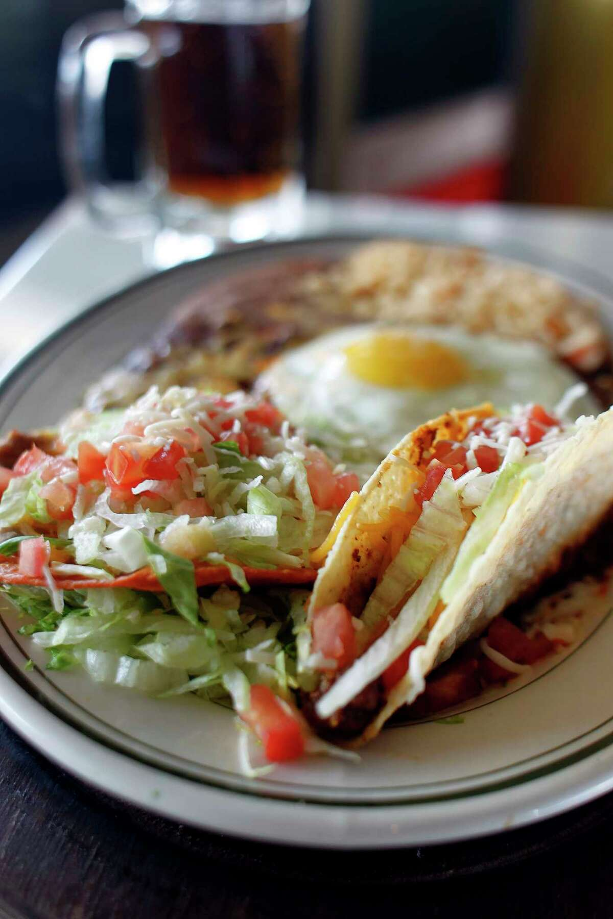 The Roosevelt Special, two cheese enchiladas with a fried egg, refried bean chalupa and a crispy beef taco at El Real Tex-Mex.