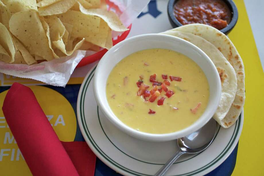 Chile con queso is served with super-thin tortilla chips at El Real Tex-Mex Cafe, 1201 Westheimer. Photo: Laurie Smith / Laurie Smith