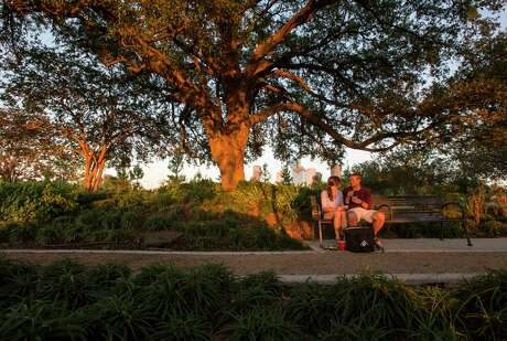 Danielle Zigon and Carter Linville watch the sunset in the Jane Gregory Garden in Buffalo Bayou Park.