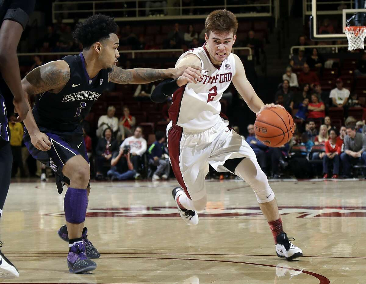 Stanford 's Robert Cartwright (2) dribbles next to Washington guard David Crisp (1) during the second half of an NCAA college basketball game Saturday, Jan. 14, 2017, in Stanford, Calif. (AP Photo/Marcio Jose Sanchez)