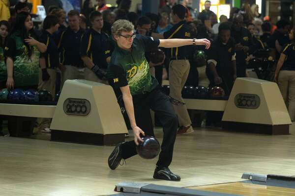 BRITTNEY LOHMILLER | blohmiller@mdn.net Dow High's Ian Matthews warms up before the start of the Saginaw Valley League bowling meet Wednesday evening at Northern Lanes.