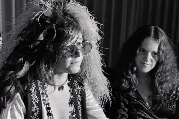 08/15/1970 - singer Janis Joplin (RIGHT) at a press conference held before her high school reunion at the Goodhue Hotel in Port Arthur, Texas, August 15, 1970. It was the tenth year reunion for the Thomas Jefferson High School class of 1960. Sitting with Joplin is her sister, Laura.