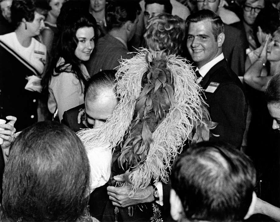 08/15/1970 - singer Janis Joplin (left) hugs classmate John Coyle at her high school reunion at the Goodhue Hotel in Port Arthur, Texas, August 15, 1970. It was the tenth year reunion for the Thomas Jefferson High School class of 1960. Photo: David Nance, HC Staff / Houston Chronicle
