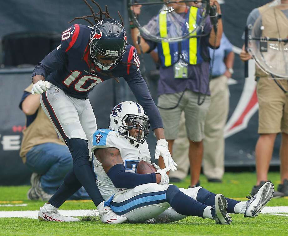 Perrish Cox of the Tennessee Titans intercepts a pass intended for DeAndre Hopkins of the Houston Texans at NRG Stadium on October 2, 2016 in Houston, Texas. Photo: Bob Levey/Getty Images
