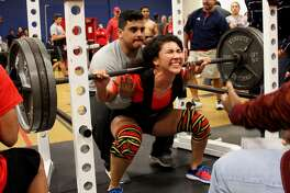 The strain shows on the face of Plainview senior Angela Banda as she tries to stand up and execute a squat lift during the Plainview Invitational powerlifting meet.