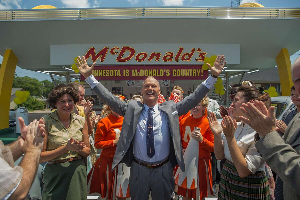 This image released by The Weinstein Company shows Michael Keaton, center, in a scene from,