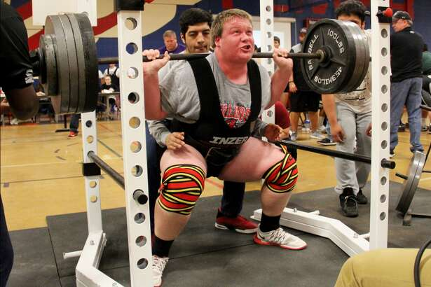 Plainview's Trevor Townsend executes a squat lift during the Plainview Invitational powerlifting meet Saturday. Townsend lifted a total of 1,440 pounds to win the super heavyweight division. He was one of seven individual winners for Plainview, which ran away with the team championship.