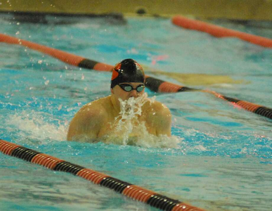 Ridgefield's AJ Bornsteinswims in the 100 breaststroke during a meet against Staples on Wednesday. Photo: Ryan Lacey / Hearst Connecticut Media