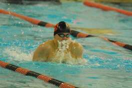 Ridgefield's AJ Bornsteinswims in the 100 breaststroke during a meet against Staples on Wednesday.