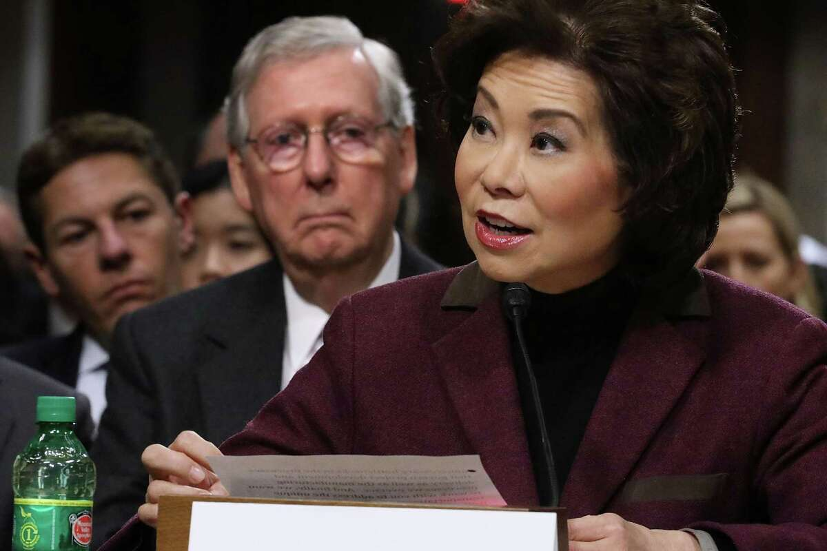 Elaine Chao testifies during her confirmation hearing to be the next U.S. secretary of transportation before the Senate Commerce, Science and Transportation Committee as her husband, Senate Majority Leader Mitch McConnell, looks on. Donald Trump's minority Cabinet picks will run relatively low-level departments in terms of presidential succession.