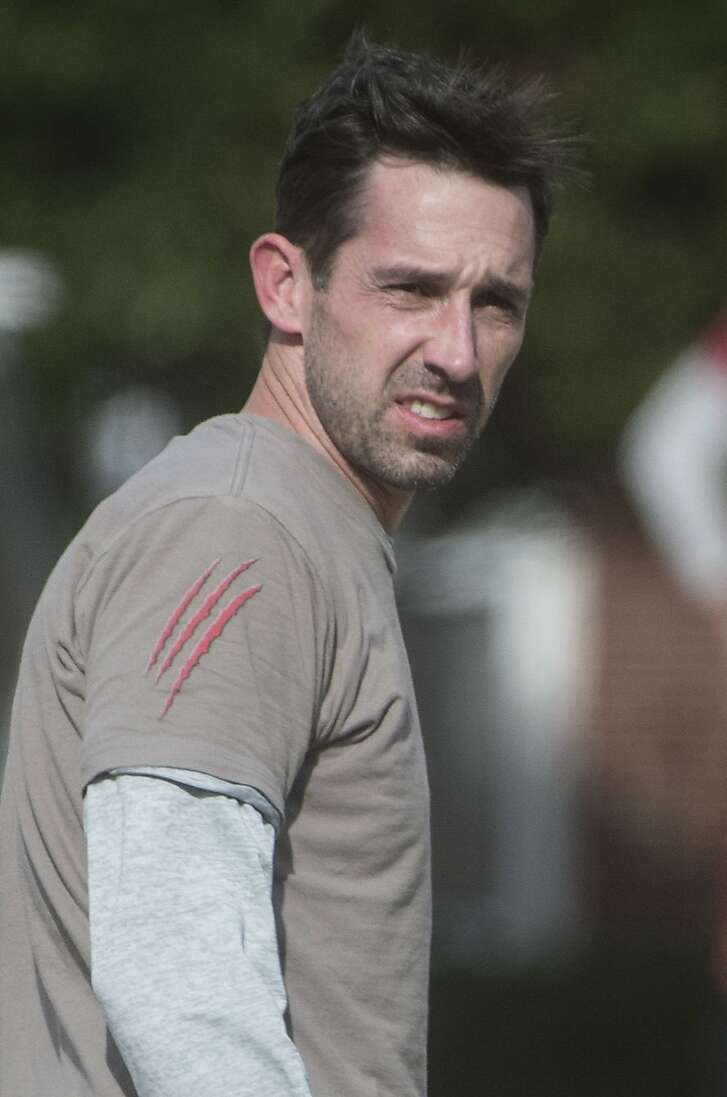 Atlanta Falcons offensive coordinator Kyle Shanahan watches practice Wednesday, Jan. 18, 2017, in Flowery Branch. The Falcons host the Green Bay Packers in the NFC Championship football game on Sunday in Atlanta. (AP Photo/John Amis)
