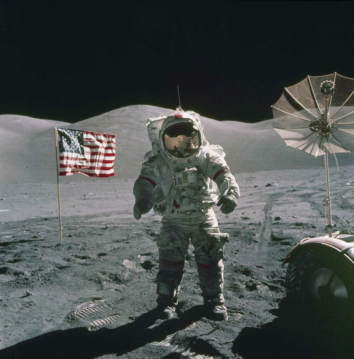 In this Dec. 12, 1972, photo provided by NASA, Apollo 17 commander Eugene Cernan stands on the moon. (NASA via AP)