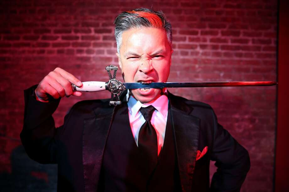 Lynx the Animator bites down on a sword for a portrait at the Exit Theatre on Wednesday, Jan. 18, 2017 in San Francisco, Calif. He is performing at the second-annual Fog City Magic Fest taking place at the theatre Jan. 25-28. Photo: Santiago Mejia, The Chronicle
