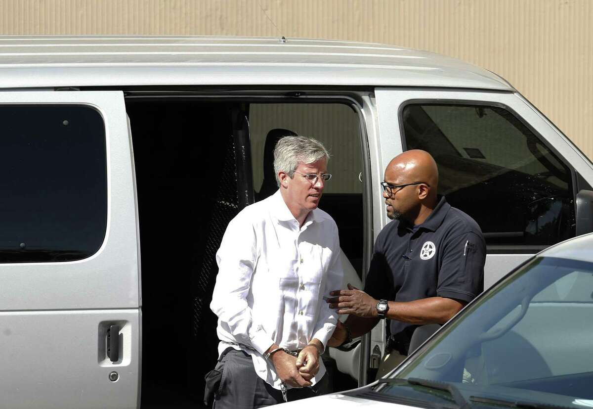 Tim Duncan's former financial adviser, Charles Banks, is transported to federal court early Friday morning after he turned himself in on federal charges. Banks was apparently indicted this week in connection with allegations that he duped Duncan into making certain investments, losing between $1.1 million and $25 million of Duncan's money on Friday, September 9, 2016.