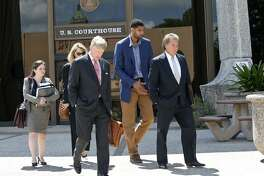 Tim Duncan exits proceedings with his legal team after he makes an appearance in federal court before U.S. District Judge Xavier Rodriguez regarding his lawsuit against Charles Banks on June 10, 2015.  From left are attorney Jacqueline Garza-Rothrock, consultant Wendy Kowalik, attorney J. Tullos Wells, Duncan and attorney Michael D. Bernard.