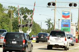 Traffic moves along Rayford Road at the Union Pacific train tracks. Commissioner James Noack will begin construction to widen the road to six lanes along with a bridge over the track this year.