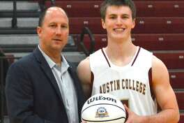 Austin College basketball player Brian Baehl, a graduate of The Woodlands High School, recently scored his 1,000th career point in his college career. Posing with Baehl is Austin College head coach Rodney Wecker.